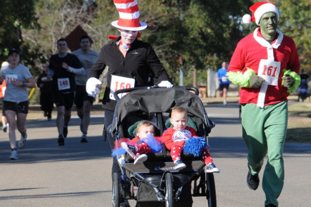 Then W0 1 Jenn Johnson and W01 Dan Johnson head for the finish line with their children, Daisy, AKA Thing 2, and Ada, AKA Thing 1, during last year's Spooky 5k. This year's event is Oct. 27 at 9 a.m. at the Fortenberry-Colton Physical Fitness Facility.