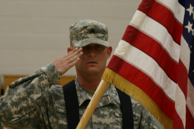 """FORT CARSON, Colo. """" Sergeant Joshua Clark, cavalry scout, Headquarters and Headquarters Troop, 1st Squadron, 10th Cavalry Regiment, 2nd Brigade Combat Team, 4th Infantry Division, salutes the colors during an awards assembly at Aragon Elementary School, Oct. 15, 2012. Clark was part of the color guard that presented the American Flag during the assembly. Fort Carson's Adopt-A-School program partners battalions with schools to get Soldiers involved in the community."""