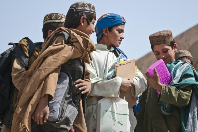 Afghan children show off their new school supplies given to them by soldiers with the 5th Kandak, 3rd Brigade, 205th Corps at the Pir Mohamed School in Sanjeray, Afghanistan, Oct. 11, 2012.