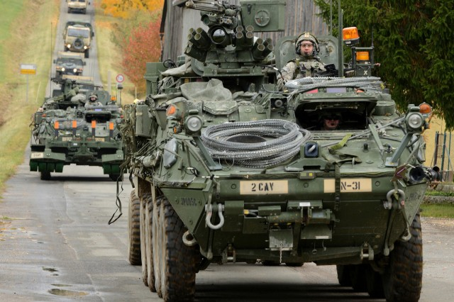 Elements of U.S. Army Europe's 2nd Stryker Cavalry Regiment enter the village Schalkenthan, near Grafenwoehr, Germany, during Saber Junction 2012, Oct. 15, 2012. Saber Junction trains U.S. personnel and 1,800 multinational partners from 18 nations.