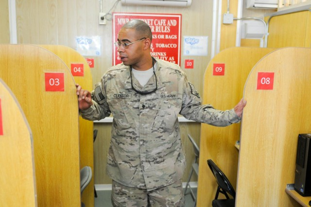 Spc. Truman Claytor, a chemical, biological, radiological and nuclear specialist with the 3d Sustainment Command (Expeditionary) and Joint Sustainment Command - Afghanistan, checks out the new MWR facility during its grand opening on Sept. 26. The new MWR facility will afford soldiers and civilians of the JSC-A and 3d Sustainment Command (Expeditionary) an opportunity to take care of their communications needs without leaving their compound.
