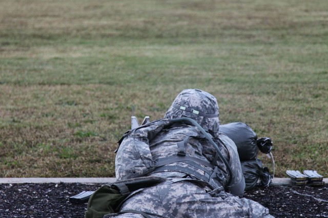 U.S. Army Soldier zeroes his M-4 rifle during the Department of the Army Best Warrior competition at Fort Lee Va., Oct. 15, 2012. Twenty-four competitors from twelve commands test their ability to subdue urban battle simulations, physical fitness tests, and warrior task and drills essential for theater battle readiness.