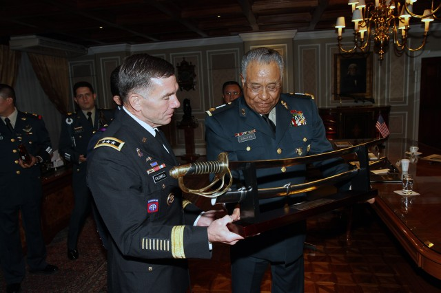 FORT SAM HOUSTON, Texas - Lt. Gen. William Caldwell IV, commanding general, U.S. Army North, and senior commander, Fort Sam Houston and Camp Bullis, presents a farewell gift to Mexican military Gen. Guillermo Galvan at Secretaria de la Defensa Nacional headquarters Oct. 11 in Mexico City. Galvan is the Mexican military equivalent to the Secretary of Defense and will be relinquishing command at the end of the year.  (Photo by Sgt. Lee Ezzell, Army North PAO)