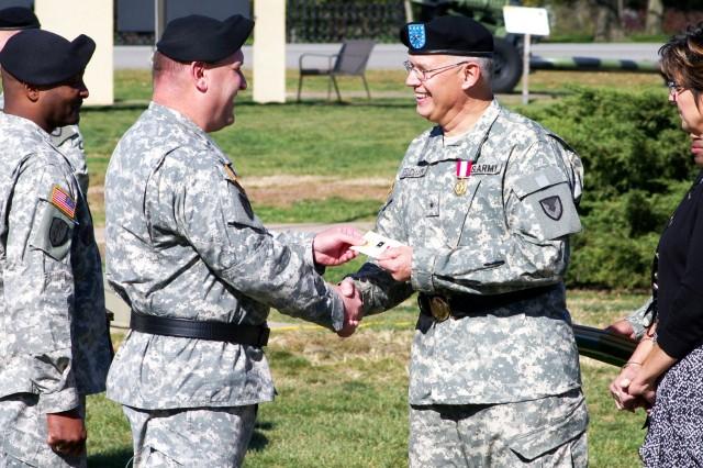 "Brig. Gen. John F. Wharton, commanding general, Army Sustainment Command, presents Brig. Gen. Steven J. Feldmann his Army ""Retired"" lapel pin. (Photo by Keith Claussen, ASC Public Affairs)"