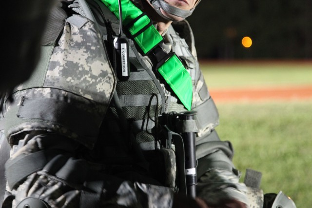 A Soldier stands ready during the night land navigation event at the U.S.Army 2012 Best Warrior competition at Fort Lee, Va., Oct. 16, 2012. Land navigation traverses through unfamiliar terrain by foot; includes the ability to read maps, the use of Defense Advanced GPS Receiver, and navigational skills, essential for theater battle readiness.