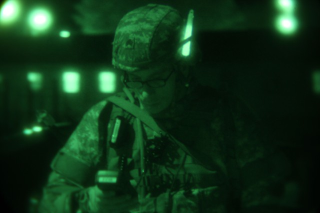 A Soldier determines grid coordinates during the night land navigation event during the U.S. Army 2012 Best Warrior competition at Fort Lee, Va., Oct. 16, 2012. Land navigation traverses through unfamiliar terrain by foot; includes the ability to read maps, the use of Defense Advanced GPS Receiver, and navigational skills, essential for theater battle readiness.