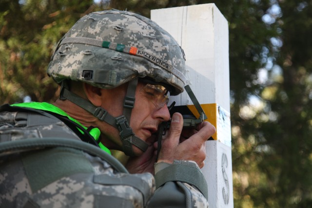 A Soldier determines the magnetic azimuth to the next position using the compass during the land navigation event at the U.S. Army 2012 Best Warrior competition at Fort Lee, Va., Oct. 16, 2012. Land navigation traverses through unfamiliar terrain by foot; includes the ability to read maps, the use of compass, and navigational skills, essential for theater battle readiness.