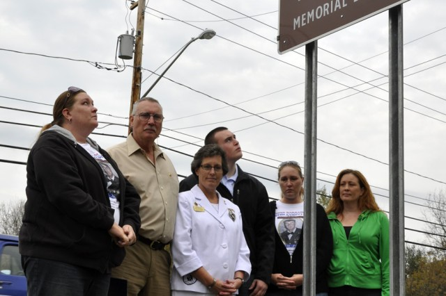 The Farley family after the unveiling of the Staff Sergeant Derek Farley Memorial Bridge sign.  From left: Theresa, sister; Ken, father; Carrie, mother; Dylan, brother; Colleen, sister; and Julie, sister. Farley was explosive ordnance disposal technician who was killed in Afghanistan.