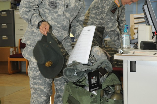 Staff Sgt. Zandra Santana, 1st Battalion, 389th Regiment, 98th Infantry Division, Army Reservist from Puerto Rico, packs her gear at the Central Issue Facility. Santana is a mobilized drill sergeant on Fort Leonard Wood for six months as part of a program to place more female drill sergeants into training units.