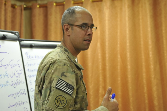Sgt. Andrew Brechko, a New York National Guardsman from the 27th Infantry Brigade Combat Team, leads a teachers' seminar held at Forward Operating Base Spin Boldak in Afghanistan, Oct. 12, 2012. The seminar focused on teaching strategies like student assessment, teacher collaboration and establishing clear teaching objectives.