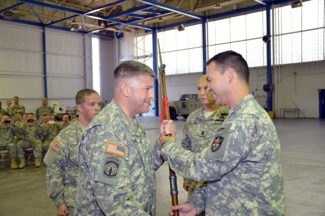 Command Sgt. Maj. Josheph A. Thill, 117th Space Battalion command sergeant major, receives the Noncommissioned Officer halberd from Lt. Col. Martin Bortolutti, 117th Space Bn. commander, during a Change of Responsibility Oct. 14.