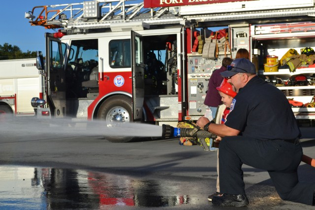 The fire hose station was a huge hit with children during the Firefighter for a Day event Oct. 9.