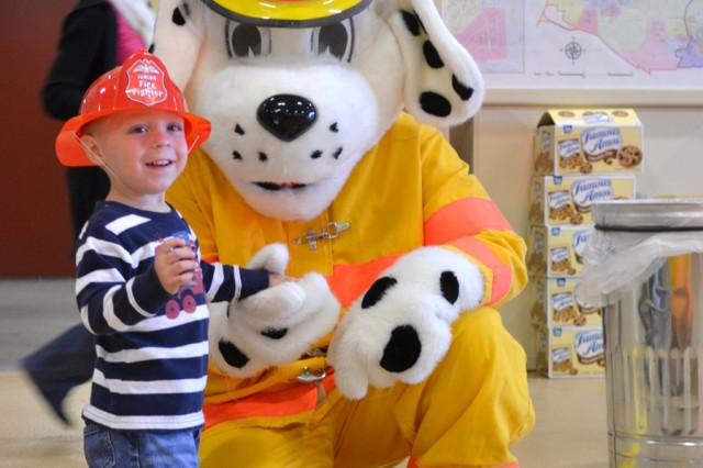 Sparky the fire dog poses with a future firefighter Oct. 9 at Fire Station 2.