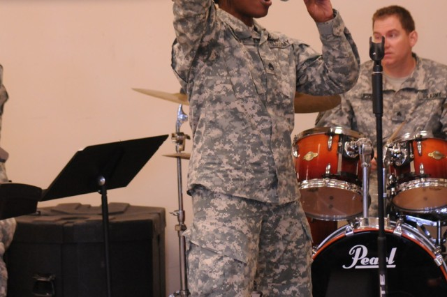"Staff Sgt. Linda Wolfe rehearses with ""Avalanche,"" the 10th Mountain Division Band's rock ensemble."
