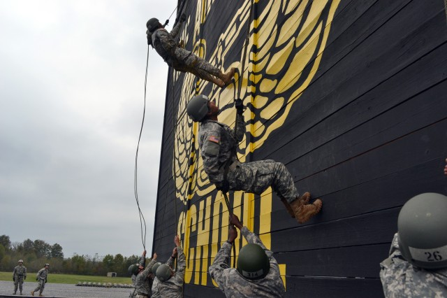Pfc. Carlos Verdejo (center), a cavalry scout with Troop A, 1st Battalion, 32nd Cavalry Regiment, 101st Airborne Division (Air Assault), keeps his eye on the trainer at the top of the tower as he completes his rappel, Oct. 12, 2012, at the Sabalauski Air Assault School at Fort Campbell, Ky. Over the next three years, 70 percent of the 101st Abn. Div. Soldiers will be Air Assault qualified.