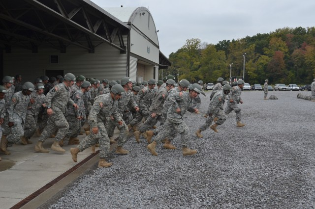 Soldiers with the 159th Combat Aviation Brigade, along with others with the 101st Airborne Division (Air Assault), run to their respective places for a formation, Oct. 12, 2012, at the Sabalauski Air Assault School at Fort Campbell, Ky. The grueling 10-day course, teaches sling-load operations, rappelling and fast-rope techniques as it challenges Soldiers' levels of discipline and their physical and mental capabilities.