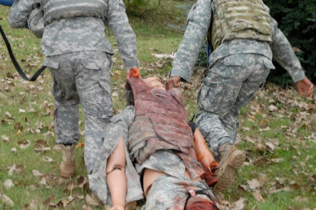 Specialist Nicholas Jones, a 24-year-old rifleman from Chicago, Ill. and Spc. Aaron Abney, a 29-year-old rifleman from Richmond, Ky., both from 1st Squadron, 33rd Cavalry Regiment, 3rd Brigade Combat Team, 101st Airborne Division hastily drag a simulated casualty out of a hostile area to provide treatment near their headquarters building Oct. 11 while conducting combat life-saver training. This type of training teaches non-medical personnel to apply treatment to their battle buddies in combat situations when medics are not present, which greatly improves chances of survival. (U.S. Army photo taken by Sgt. Alan Graziano, 3rd Brigade Combat Team, 101st Airborne Division)