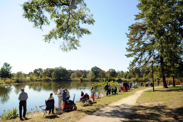 Competitors and their families line the banks of Burba Lake. Youth anglers spend Saturday morning casting fishing rods and spending quality time with families.
