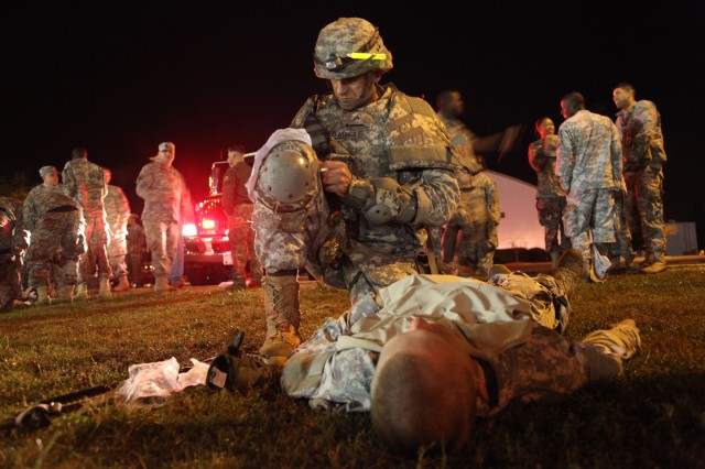 A Soldier evaluates and treats a casualty during the mass casualty event at the Department of the Army Best Warrior competition at Fort Lee, Va., Oct. 17, 2012. A combat life saver provides care and prepares casualties for evacuation when he or she has no combat duties to perform.
