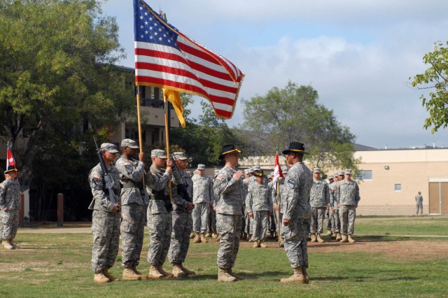 """FORT HOOD, Texas """" Long Island, N.Y. native, Command Sgt. Maj. David L'Elie (right), current senior noncommissioned officer of the 2nd Battalion, 8th Cavalry Regiment, 1st Brigade Combat Team, 1st Cavalry Division, prepares to take charge of his battalion formation, following the change of responsibility ceremony, here, Oct. 10."""