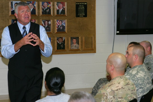 Bob Delaney, NBA Cares ambassador, speaks with Warrior Transition Unit Soldiers at Fort Sill, Okla., in April about his experiences as an undercover New Jersey state policeman and his battles with post traumatic stress. Delaney will speak at Fort Rucker Oct. 23-24.