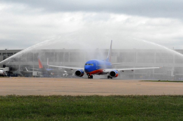 "AUSTIN, Texas "" As the Honor Flight participants prepare for take-off as the Austin Fire Department pays respect to the veterans with a waterfall salute, here, Oct. 9. This flight consisted of World War II Veterans living in Travis, Williamson, Hays, Bastrop and Caldwell, Texas counties."