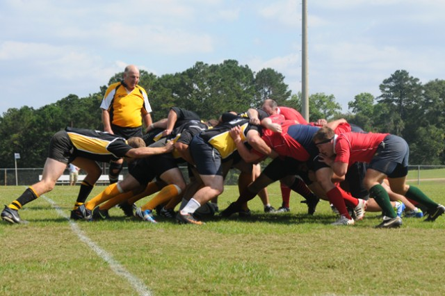 The Fort Rucker Fliers fight for possession of the ball in a scrum during a game on Oct. 13 against Mobile Battleship.
