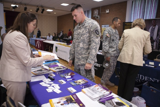 (From the left) Victoria Pridemore, military outreach representative with Excelsior College, talks to Sgt. Greg Bartholomew, 289th MP Company, during an education and career fair held by the Education Center on Joint Base Myer-Henderson Hall Oct. 17 in the Community Center (Photo by Rachel Larue).