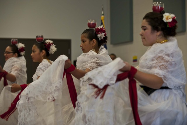 "Members of Folklorico Productions, a non-profit educational and cultural organization, from Columbus, Ind., perform a Columbian dance called, ""La Bruja,"" or the ""The Witch Dance,"" during the 205th Infantry Brigade Hispanic Heritage Month observance at the Sgt. Charles H. Seston U.S. Army Reserve Center, Oct. 12. The dance was part of a celebration of Hispanic Heritage and to increase the awareness of Hispanic service members and their contributions.  The 3-411th Logistic Support Battalion, one of three Reserve battalions under the 205th Infantry Brigade, sponsored the event which included traditional dances from both, Mexico and Columbia, by dancers from Folklorico Productions, a non-profit educational and cultural, Columbus, Ind. (U.S. Army photo by Staff Sgt. Reginald Graddy)"