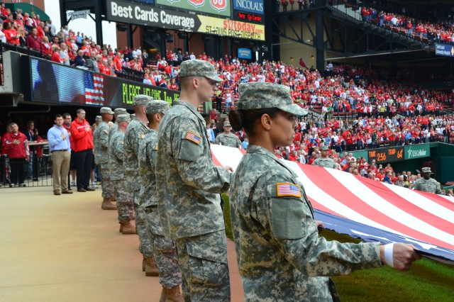 Soldiers from Fort Leonard Wood, Mo., unfurl a flag during Game 3 of the National League Championship Series, Oct. 17, 2012, at Busch Stadium in St. Louis.