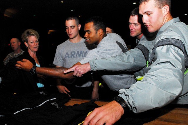 Beverly Kimball, the project engineer for the Army physical fitness uniform with the Program Executive Office, lays out prototypes for the new PFU shorts for Soldiers to choose and try on during the PEO Road Show, Oct. 17, 2012, at Joint Base Lewis-McChord, Wash.
