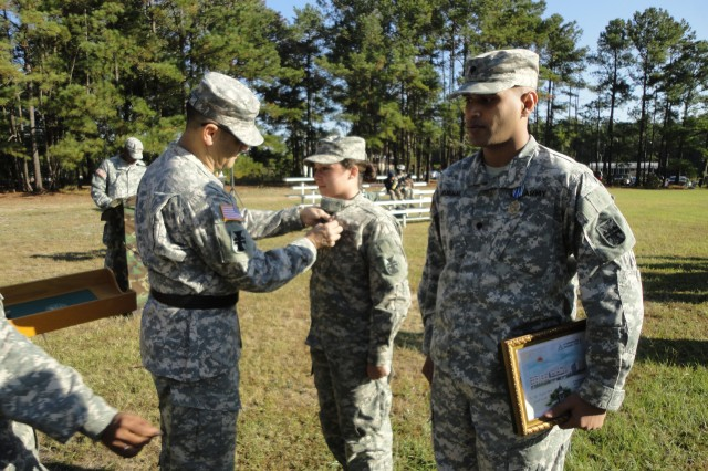 FORT JACKSON, S.C.--Maj. Gen. William Buckler, Jr., commander of 412th Theater Engineer Command, presents Pfc. Lindsey, intelligence analyst and native of Columbia, S.C., with the Army Achivement Award in support of Operation Key Resolve, during a ceremony held here Oct. 13, 2012.