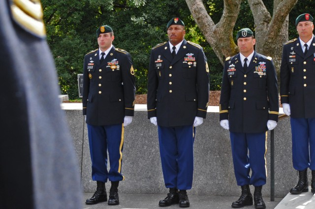 Special Forces Soldiers representing four of the seven Green Beret groups line the pavilion where President John F. Kennedy lies at Arlington National Cemetery, Va. Nearly every year since his death in 1963, Special Forces Command (Airborne) places a wreath honoring JFK for his vision in building a dedicated counter-insurgency and unconventional warfare force that today is deployed to some 50 countries.