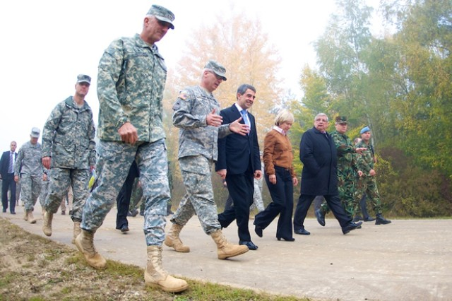 U.S. Army Europe Commander Lt. Gen. Mark Hertling (foreground) and USAREUR Deputy Commander Maj. Gen. James Boozer (right of Hertling) accompany the President of the Republic of Bulgaria, Rosen Asenov Plevneliev (right of Boozer), to exercise Saber Junction at Ubungsdorf on Germany's Hohenfels Training Area, Oct. 19, 2012.