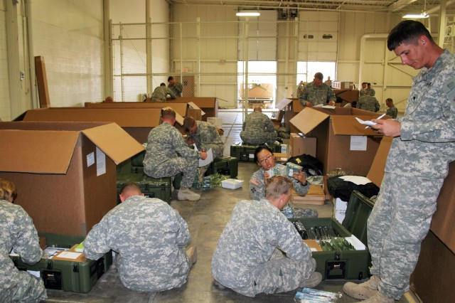 """FORT CARSON, Colo. """" Soldiers with 2nd Brigade Combat Team, 4th Infantry Division, inventory medical equipment during their medical reset Oct. 16, 2012. Each battalion within the brigade received new equipment, which had to be inventoried. The reset is important in keeping Soldiers current with new technology and equipment."""
