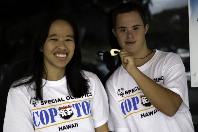"""KAILUA, Hawaii """" Two Special Olympics Athletes pose for a photo during Cop on Top, a three day event where law enforcement and Special Olympics partner to raise Special Olympics awareness, here, Sep. 28, 2012."""