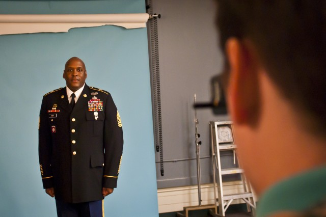 Command Sgt. Maj. Nathan Hunt's, command sergeant major for the 8th Theater Sustainment Command, has his Department of the Army photograph taken by Mike Phillips, DA photographer, at the DA studio, Sept. 26.