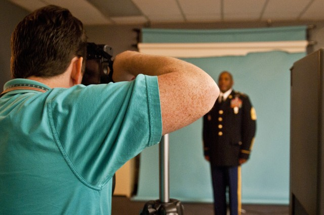 Mike Phillips, Department of the Army photographer, takes Command Sgt. Maj. Nathan Hunt's, command sergeant major for the 8th Theater Sustainment Command, DA photo at the DA studio, Sept. 26.