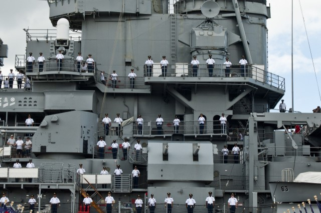 Noncommissioned officers from the 8th Theater Sustainment Command stand at attention along the deck of the vessel, honoring the host and NCO Corps during the 8th TSC's NCO Call, Sept. 21, held at the USS Missouri.
