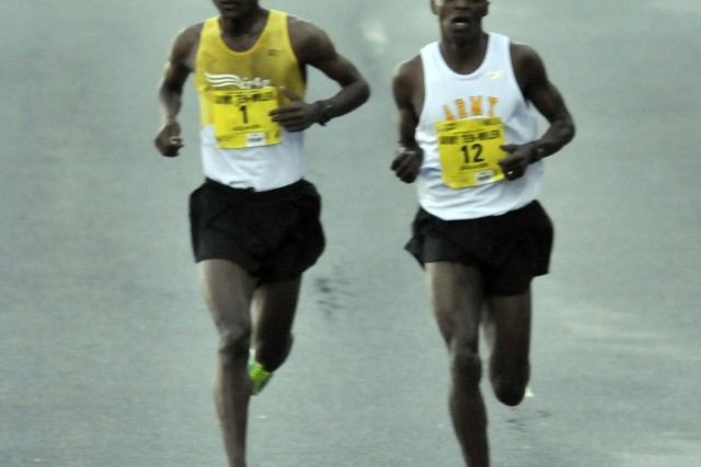 Frontrunners Tesfaye Sendeku-Alemyehu of Ethiopia (left) and U.S. Army World Class Athlete Spc. Augustus Maiyo run the Army Ten-Miler side by side and jockey for the lead over the first nine miles, Oct. 21, 2012.