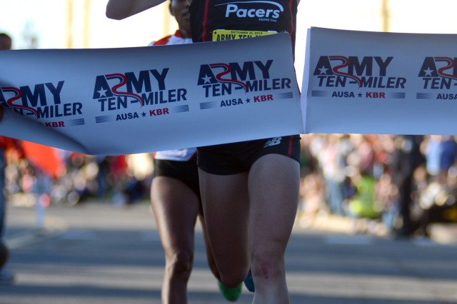 Kerri Gallagher, 23, of Washington, D.C., breaks the tape to win the women's division of the 28th running of the Army Ten-Miler with a time of 56 minutes, 9 seconds, Oct. 21, 2012, at the Pentagon.
