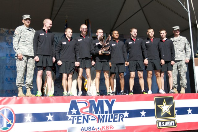 St. John's (Minn.) University Cadets receive their trophy Sunday after winning the ROTC division of the Army Ten-Miler. Photo by Steve Arel/U.S. Army Cadet Command