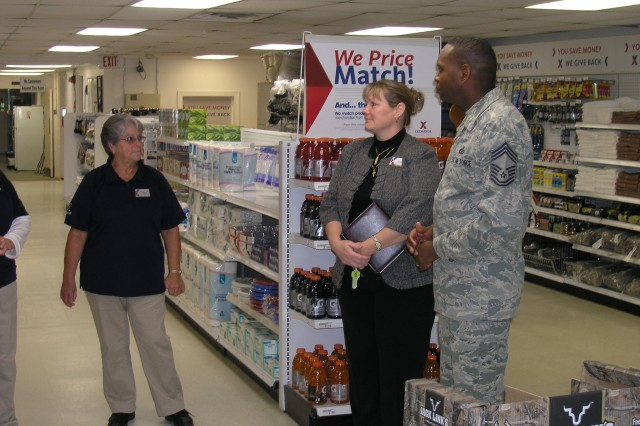 Martha Kinzer speaks with Rebecca A. Santee, General Manager Fort Belvoir Exchange and Chief Master Sgt. Tony Pearson, the senior enlisted advisor for the Army & Air Force Exchange Service, during their visit to Fort A.P. Hill PX.