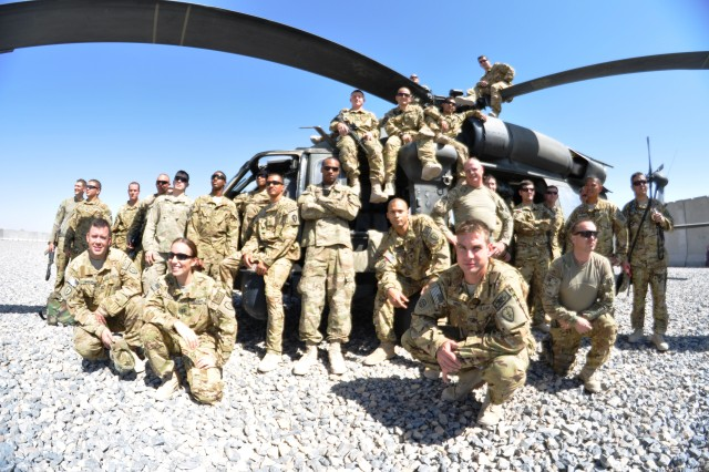 The flight crews of Company C, 3rd Battalion, 25th Aviation Regiment, 25th Combat Aviation Brigade, pose in front of a UH-60 Black Hawk located in Pasab, Afghanistan, in late September.