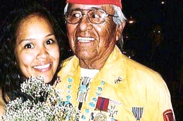 Pfc. Chelsea Draper with her grandfather, retired Marine Sgt. Maj. Teddy Draper Sr., in Chinle, Ariz. Draper Sr.'s service as a code talker during World War II inspired Pfc. Draper to join the military.