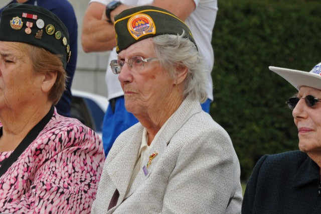 Army veterans listen to guest speakers at the 15th anniversary of the dedication of the Women in Military Service for America Memorial at Arlington National Cemetery, Va., Oct. 20, 2012.