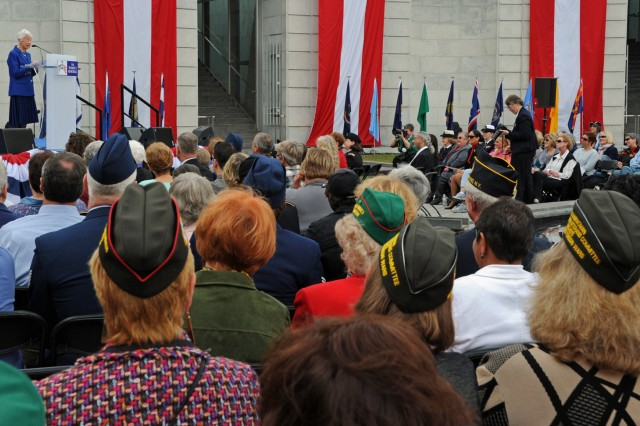 Veterans from all service branches listen to World War II Army Nurse Corps veteran retired Lt. Col. Louise Whalen. The women veterans gathered for the 15th anniversary dedication of the Women in Military Service for America Memorial at Arlington National Cemetery, Va., Oct. 20, 2012.