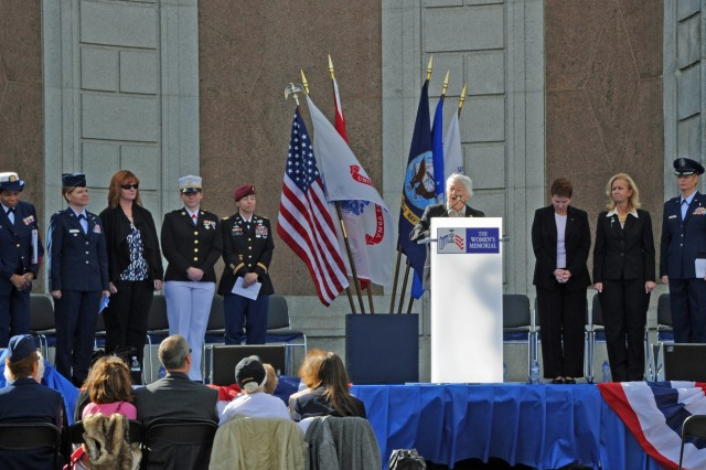 Flanked by active duty and retired women service members, Wilma L. Vaught, president of the Women's Memorial Foundation opens the 15 anniversary celebration of the dedication of the Women in Military Service for America Memorial, Oct. 20, 2012, at Arlington National Cemetery, Va.