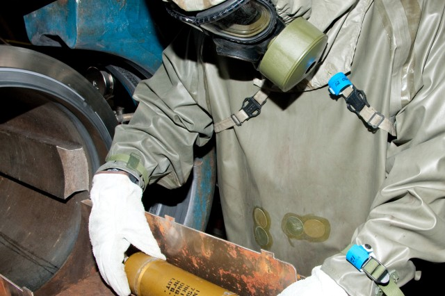 A CBARR EDS operator secures a chemical munition during an operation at Dover Air Force Base in September.