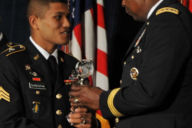 Soldier of the Year Sgt. Saral Shrestha receives his award from Vice Chief of Staff of the Army Gen. Lloyd J. Austin III, during the Association of the U.S. Army's Sergeant Major of the Army Awards Luncheon.
